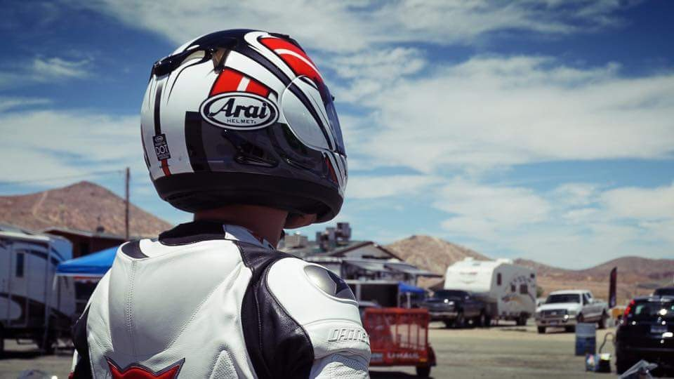 A motorcycle rider wearing a helmet and leathers