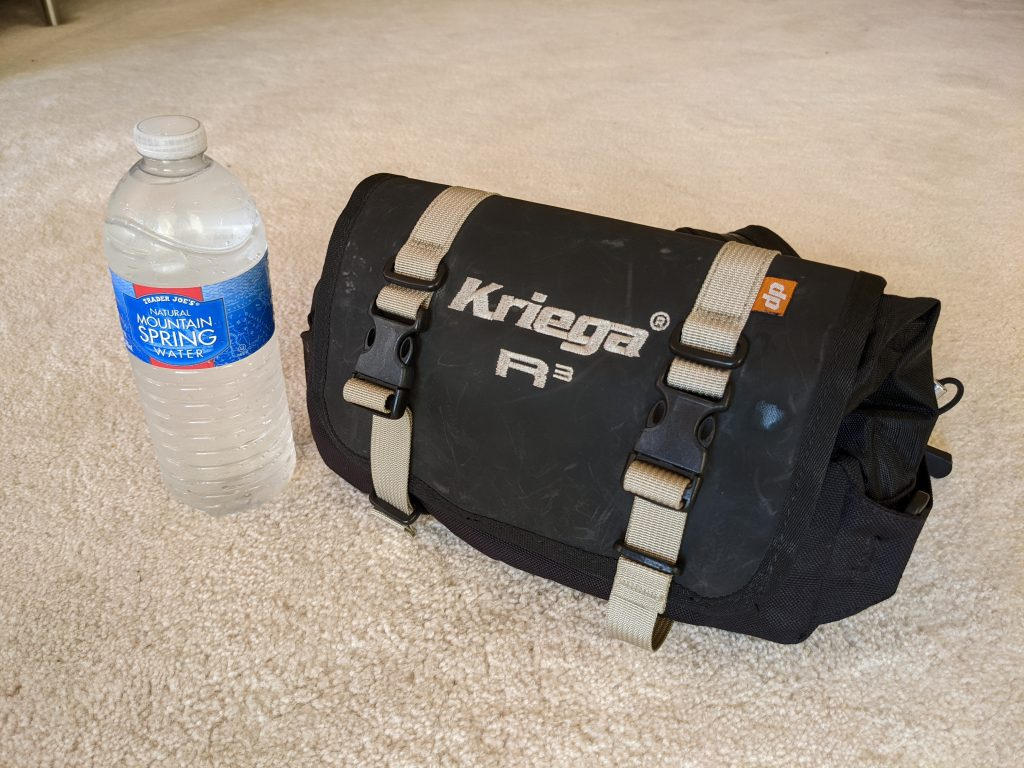 Motorcycle fanny pack for holding water to stay hydrated when riding